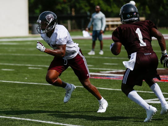 Missouri State wide receiver Malik Earl (left) runs