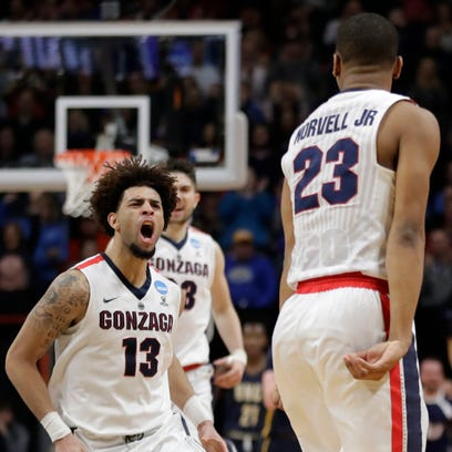 Norvell rescues Zags in first-round win
