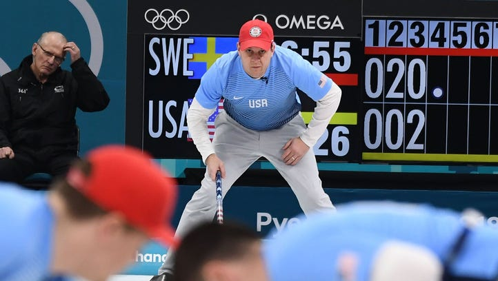 John Shuster of the USA looks on as his team sweeps