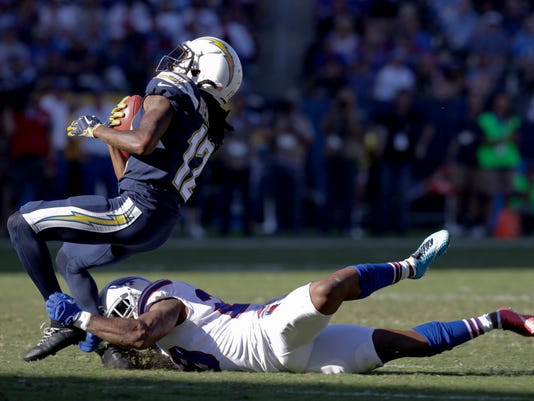 Los Angeles Chargers wide receiver Travis Benjamin, left, is tackled by Buffalo Bills defensive back Shamarko Thomas during the first half of an NFL football game Sunday, Nov. 19, 2017, in Carson, Calif. (AP Photo/Jae C. Hong)