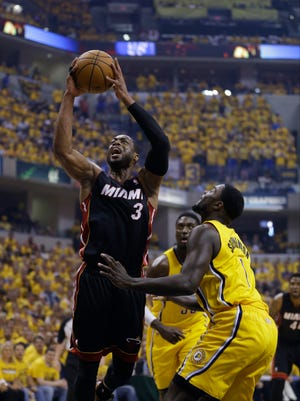 Miami Heat guard Dwyane Wade (left) shoots against Indiana Pacers guard Lance Stephenson during the first half of Game 2 of the Eastern Conference finals on Tuesday.