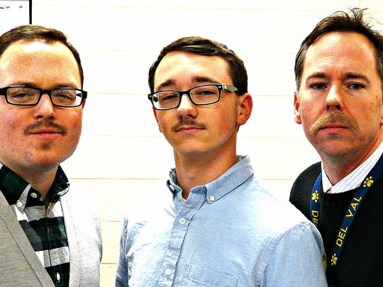 Del Val Junior Pierce Werrmann (center) overrode his own fashion sense to grow a mustache for his role in the musical '9 to 5.' His director Clinton Ambs (left) and the musical director James Schnyderite (right) are also wearing mustaches in solidarity.