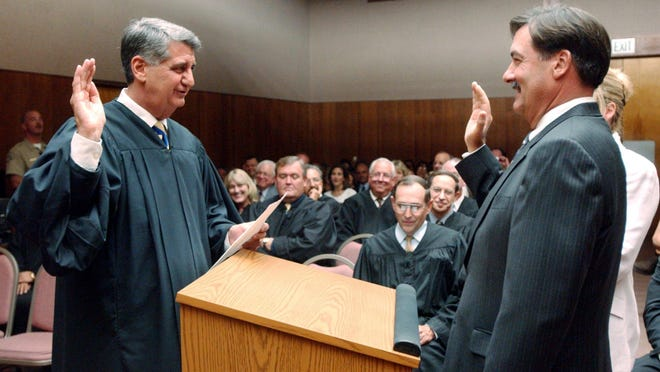 Gary Paden (pictured right) is sworn in by Tulare County Superior Court Judge Joseph Kalashian in 2005.