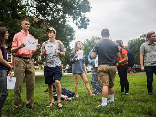 "Students protest Clemson University's ""designated free speech areas"" by presenting a prayer rally Friday in Clemson."