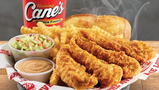 The combo at Raising Cane's is Four chicken fingers is a meal of crinkle-cut fries, Texas toast, coleslaw, a regular drink and Cane's Sauce.