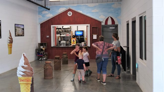 The new red dairy barn inside the entrance to the Expo Center at Harvest Ridge is the place to get soft serve ice cream treats at the Holmes County Fair this year.