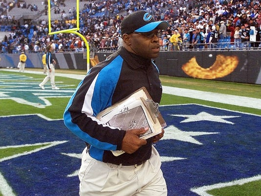 "FILE - In this Nov. 16, 2003, file photo, Carolina Panthers linebackers coach Sam Mills leaves the field after the Panthers' game against the Washington Redskins in Charlotte, N.C. The Panthers motto is everywhere, on stadium walls, plaques and even the team jerseys: ""Keep Pounding."" The advice comes from Mills, a Panthers linebacker who died of intestinal cancer and is honored with a statue outside the team's stadium.  (AP Photo/Rick Havner, File)"