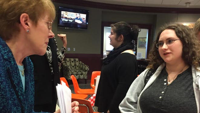 Kathy White Loyd (left), executive director of the Women's Business Leadership Center, interacts with 18-year-old freshman Elizabeth Anderson after a presentation Thursday at Arkansas State University-Mountain Home. WBLC provides mentorship to women.