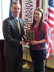 Mansfield University President Fran Hendricks presents the Employee of the Year Award to Gretchen Sechrist.
