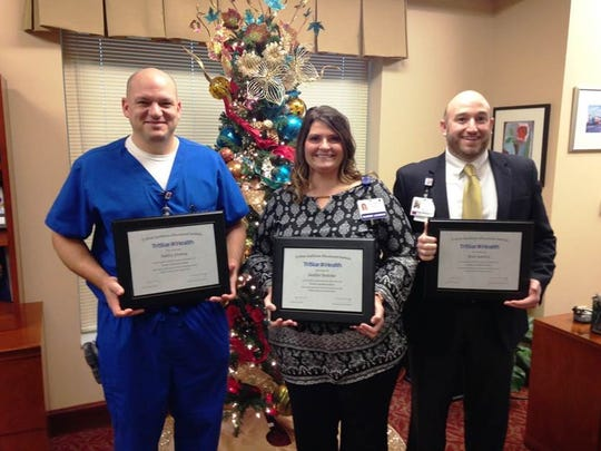 TriStar StoneCrest Medical Center employees Ashley Fleming, left, Heather Bratcher and Paul Hartley