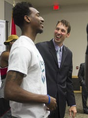 Marty Richter, a former assistant at FGCU, takes the men's basketball coaching job at Florida SouthWestern State College, which opens play in 2016 in the new Suncoast Credit Union Arena. Here, Richter laughs with former FGCU guard Bernard Thompson, left.