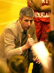 North Rockland girls basketball coach Rich Korn gives directions to his team during a time out in the first quarter at Ossining High School on February 6, 2003. Korn is one of four Section 1  coaches who will be inducted into the New York State Basketball Hall of Fame on March 26, 2017.