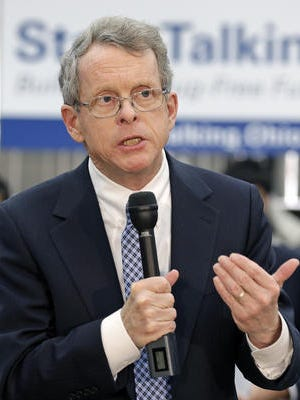 In this Jan. 8, 2014 file photo, Ohio Attorney General Mike DeWine speaks at West Carrollton Middle School in West Carrollton, Ohio.