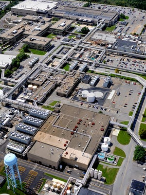 In this aerial photograph looking west, a labrynth of pipes and related infrastructure at the IBM East Fishkill campus lead from the center portion of the complex into the back of Building 323, top, where the company manufactures microchips on 300-millimeter silicon wafers.