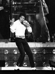"""With his jacket and glove gone, Michael Jackson performs Aug. 10, 1984 in the smallest city of their Jacksons' """"Victory Tour"""" in Knoxville, Tenn."""