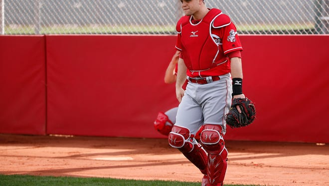 Cincinnati Reds catcher Devin Mesoraco (39) completes a bullpen session during Cincinnati Reds spring training, Tuesday, Feb. 14, 2017, at the Reds spring training facility in Goodyear, Arizona.