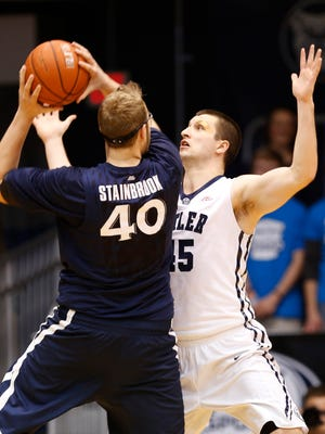 Butler's Andrew Chrabascz guards Xavier's Matt Stainbrook in the first half of the game at Hinkle Fieldhouse Saturday January 10, 2015.