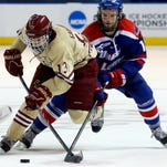 Boston College's Johnny Gaudreau  moves with the puck ahead of UMass Lowell's Adam Chapie in the third period of the NCAA Northeast Regional hockey final in Worcester, Mass., on  March 30. Boston College won 4-3.