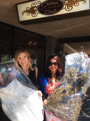 Reporters Calley Cederlof, left, and Marina Gaytan found prom dresses at Chelsea Street Boutique Monday. The two will cover Visalia and Tulare Proms May 7.