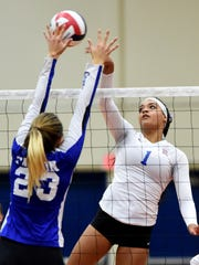 Carson's Ku'ulei Haupu looks to block a shot by Reno's Kaitlynn Biassou in Thursday's Regional semifinal game at Reno.
