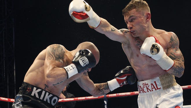Northern Ireland's Carl Frampton, right, and Spain's Kiko Martinez, left, during their IBF super-bantamweight world title bout at a purpose-built 16,000 outdoor arena in Belfast, Northern Ireland, Saturday, Sept. 6, 2014.  Frampton outpointed Spain's Martinez to win the IBF belt.  (AP Photo/Peter Morrison) ORG XMIT: XBFT101