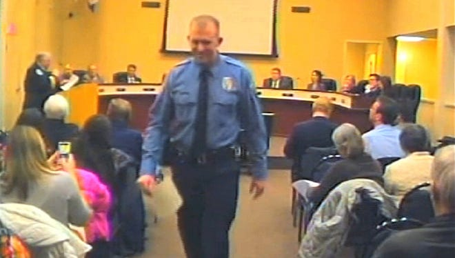 In this Feb. 11, 2014, file image from video provided by the City of Ferguson, Mo., officer Darren Wilson attends a city council meeting in Ferguson. Wilson is not expecting to face criminal charges from a Missouri grand jury that has been investigating the nationally watched case for the past several months, a police union official said Thursday, Nov. 20, 2014.