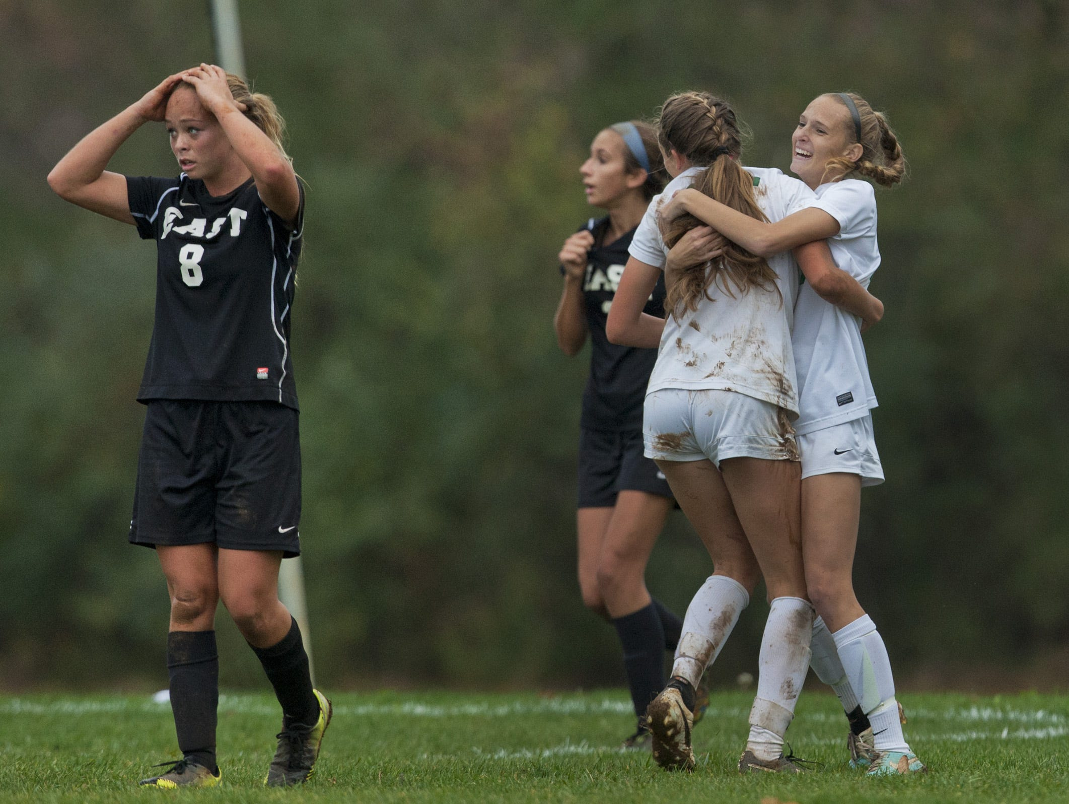 Toms River East's Kristen Lister looks shocked as Nicole Loehle (back to camera) celebrates her goal, the third for Colts Neck to take the lead 3-0 at that point. Colts Neck defeats Toms River East in NJSIAA girls soccer Central Group III final in Colts Neck on November 12, 2015