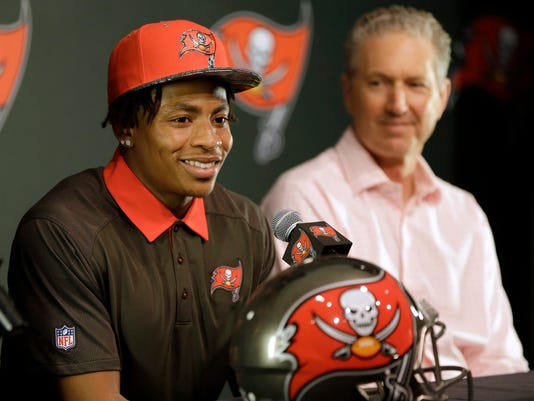 Tampa Bay Buccaneers first-round draft pick Vernon Hargreaves, left, smiles as he sits with head coach Dirk Koetter during a news conference Friday, April 29, 2016, in Tampa, Fla. Hargreaves, formally of the University of Florida, was the 11th overall pick in the draft. (AP Photo/Chris O'Meara)