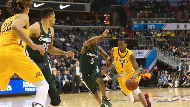 Mar 10, 2017; Washington, DC, USA; Minnesota Golden Gophers guard Dupree McBrayer (1) dribbles the ball as Michigan State Spartans guard Cassius Winston (5) defends in the second half during the Big Ten Conference Tournament at Verizon Center. Mandatory Credit: Geoff Burke-USA TODAY Sports