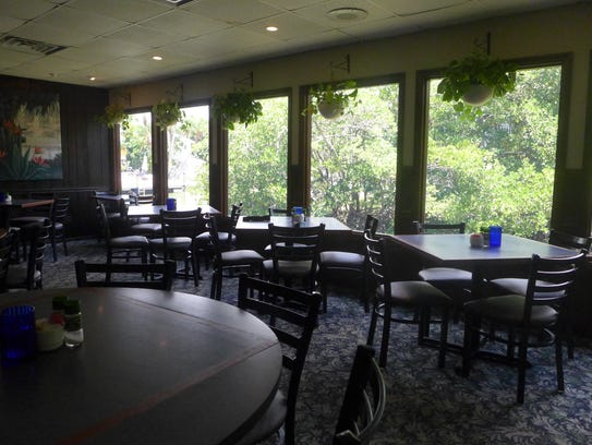 The dining room at Charley's Boat House Grill looks