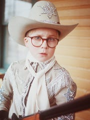 """Ralphie (Peter Billingsley) fantasizes about his ideal Christmas gift - a Red Ryder BB gun - in """"A Christmas Story."""""""