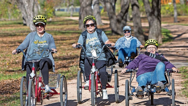 Mary Lyons (left), Yolanda Esparza (center) and Antonia Sandoval (right) complete  a group trail ride originating from the Conley-Guerrero Senior Activity Center in Austin, Texas.