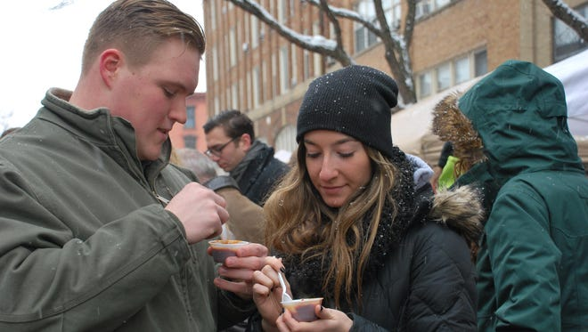 Students sample chili at the Ithaca Chili Cook-off.