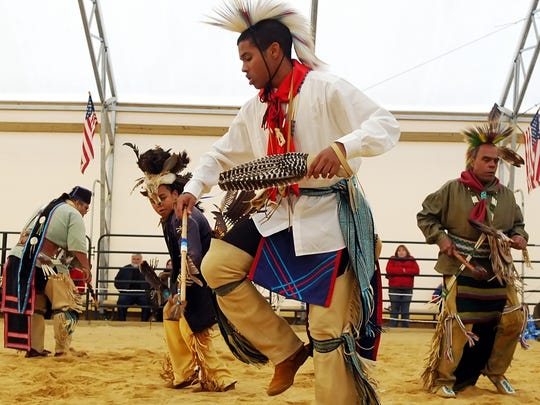 Justice Norwood of the Nanticoke Leni-Lenape tribe joins in a traditional dance with his elders and other youth during a tribal Pow Wow held at Indian Trail Farm in Vineland.