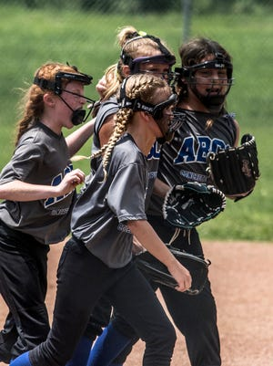 ABCO 10U players celebrate during Sunday's Licking County Shrine Tournament semifinal against Newark Gray. ABCO is coached by Miranda Fraunfelter, whose family has been the driving force behind the softball program at Mound City.