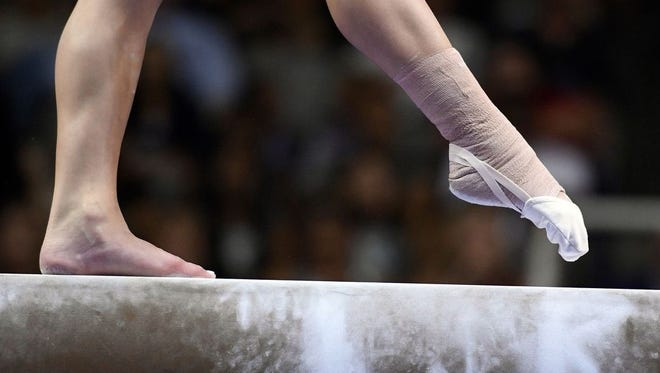 An Illinois coach has been banned by USA Gymnastics for violating its code of ethical conduct.