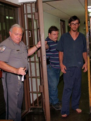 Darrell Robinson (right) was captured in Evangeline Parish after a chase in 1996 that began in Rapides Parish after the discovery of four bodies in a Poland community home where he'd been staying. He later was convicted and sentenced to death for the shooting deaths of those people, including a 10-month-old boy.