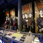 "People look at the Class of 2015 exhibit at the The Rock and Roll Hall of Fame and Museum Friday, April 17, 2015, in Cleveland. Ringo Starr, who was previously enshrined with the Beatles in 1988, will be honored along with pop punks Green Day, soul singer-songwriter  Bill Withers, underground icon Lou Reed, guitarist Stevie Ray Vaughan and Double Trouble, Joan Jett and The Blackhearts, The Paul Butterfield Blues Band and The ""5"" Royales. (AP Photo/Tony Dejak)"