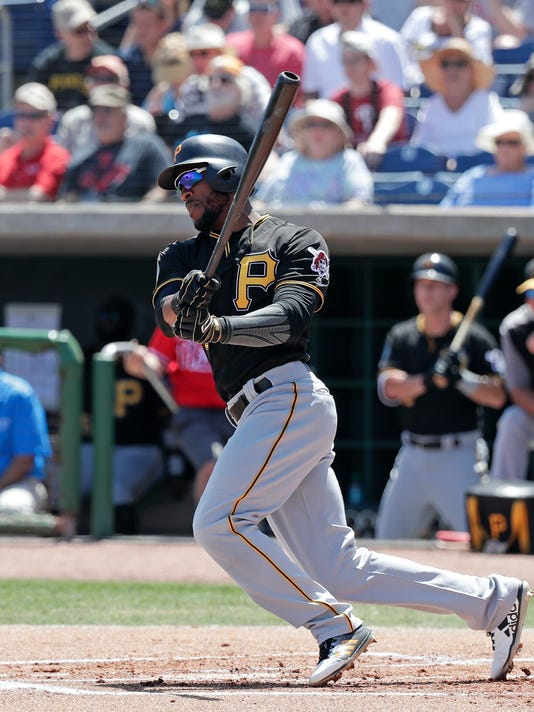 Pittsburgh Pirates' Starling Marte hits a single against the Philadelphia Phillies in the first inning of a spring baseball exhibition game, Tuesday, March 27, 2018, in Clearwater, Fla. (AP Photo/John Raoux)
