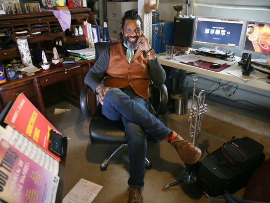 Herb Smith, at his desk where he does much of his composing,
