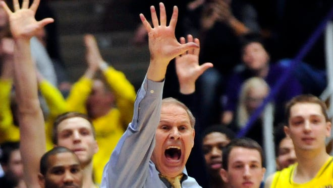 Michigan basketball coach John Beilein shouts instructions during the first overtime against Northwestern.