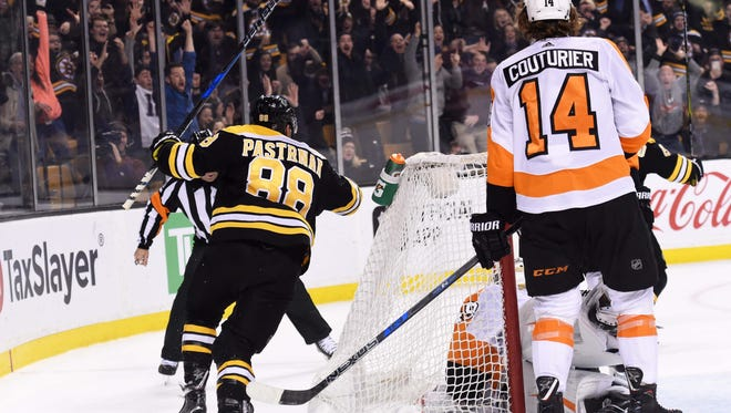 The Flyers were denied in Boston on a last-minute goal by Brad Marchand to give the Bruins a win.