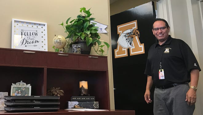 New Abilene High School Principal Michael Garcia wears his black and gold with pride. He's returning to where his school administration career began, as Abielne High was his home for seven years before he transitioned to elementary school principal for six more years.