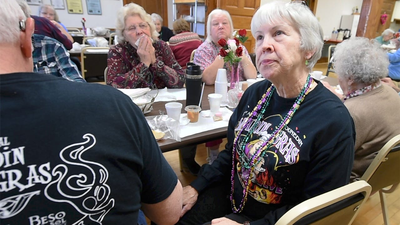 Area residents gather at the South Central York County Senior Center in New Freedom and talk about the recent developments in the Witman murder.