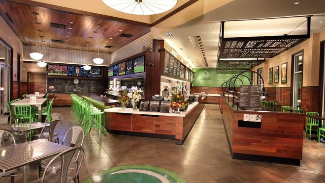 Iconic green is the corporate color used at Wahlburgers restaurants.This is the flagship store in Hingham, Mass. Other stores in the chain are modeled after this location.