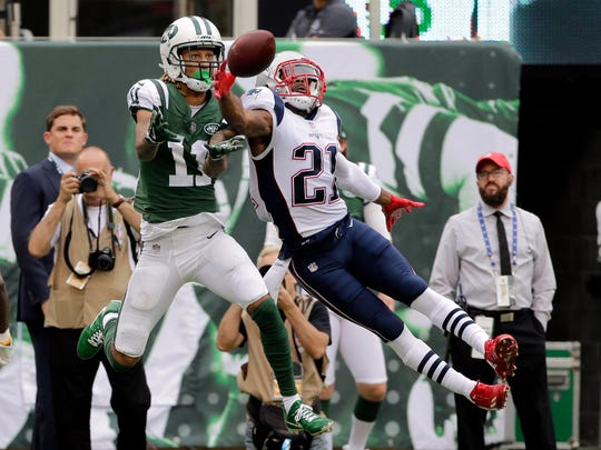 New England Patriots' Malcolm Butler (21) breaks up a pass to New York Jets' Robby Anderson (11) during the first half of an NFL football game Sunday, Oct. 15, 2017, in East Rutherford, N.J. (AP Photo/Seth Wenig)