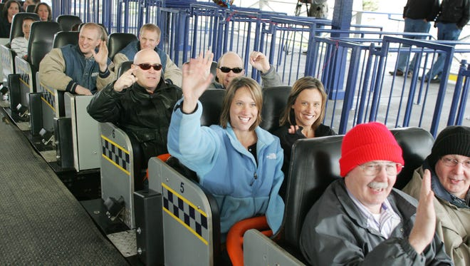 ** FILE ** Twins Beth Elkins, left, and Katie Plyler of Rock Hill, S.C. pull out of the station for another ride with other sets of twins on the Thunder Road roller coaster in a file photo from March 23, 2006, at Paramount's Carowinds in Fort Mill, S.C.  Cedar Fair LP, an Ohio-based amusement park operator, is buying the Paramount Parks business from CBS Corp. for $1.24 billion in cash, the companies announced Monday. (AP Photo/ The Herald, Andy Burriss, File)