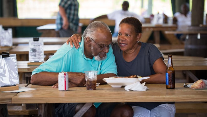 """Port St. Lucie residents Richard Lewis and wife Lawna Lewis spend time at Summer Crush Vineyard & Winery during the winery's regularly scheduled weekend festivities June 3, 2018, in St. Lucie County. """"It's the best deal in town,"""" Richard said, referring to the voluntary donation to a local non-profit at the gate. """"They always have quality music."""""""