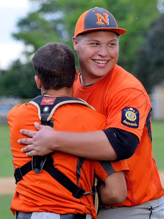Northeastern pitcher Adam Kipp, right, hugs catcher Devin Blymire after defeating Pleasureville in the York-Adams American Legion championship baseball game on Monday, 5-0. Kipp pitched the shutout.