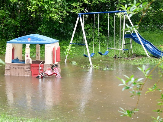 Colby Young and Kayla Barnes' flooded yard in Black